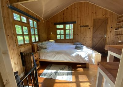 The king size double bed with views over the lake